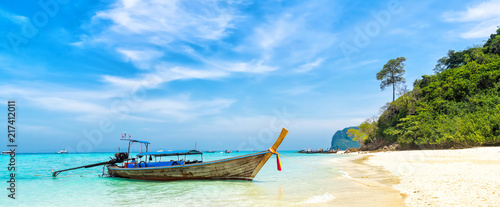 Amazing view of beautiful beach with traditional thailand longtale boat. Location: Bamboo island, Krabi province, Thailand, Andaman Sea. Artistic picture. Beauty world. Panorama