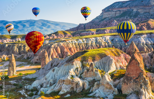 Poster Turkey The great tourist attraction of Cappadocia - balloon flight. Cappadocia is known around the world as one of the best places to fly with hot air balloons. Goreme, Cappadocia, Turkey