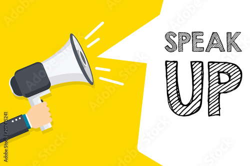 Photo  Hand holding megaphone with Speak Up text