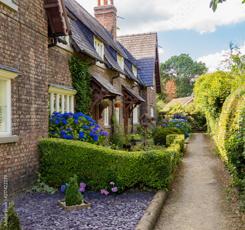Slika na platnu Beautiful original workers cottages at Styal Village, Cheshire, UK