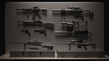 Black And Grey Firearms Displa...