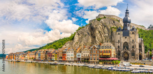 Obraz Panoramic vew at the embankment of Meuse river with houses and church of Our Lady Assumption in Dinant - Belgium - fototapety do salonu