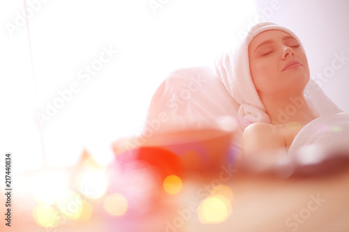 Fotografie, Obraz Young woman lying on a massage table,relaxing with eyes closed