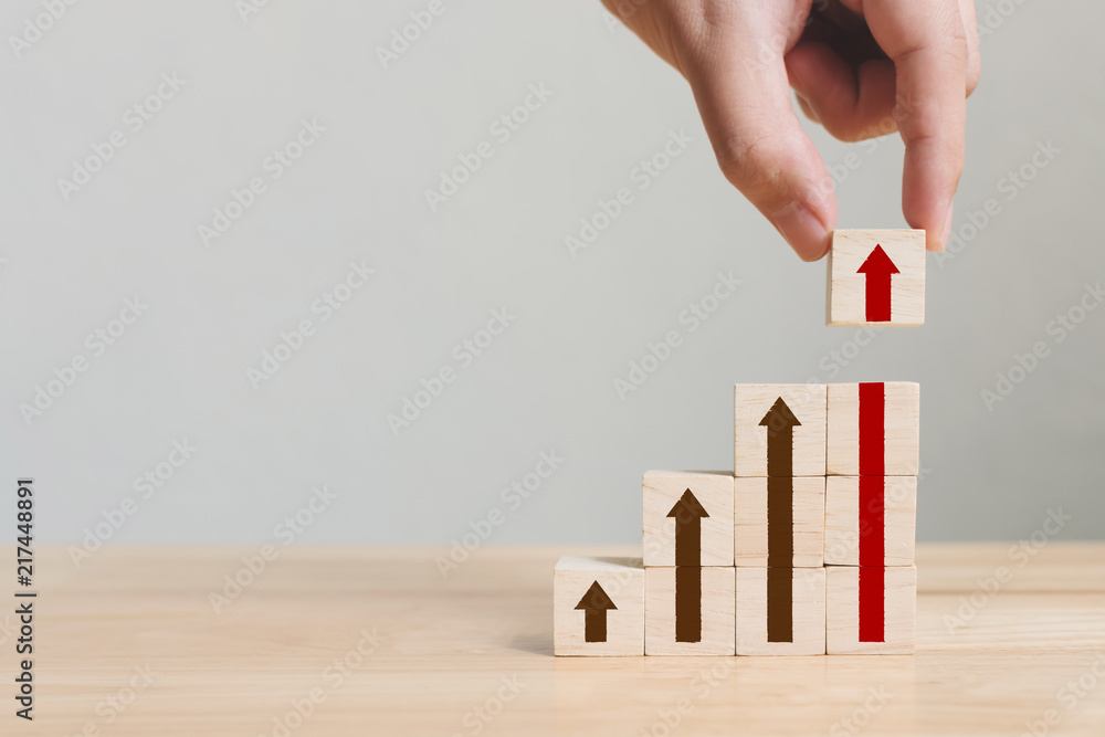 Fototapety, obrazy: Hand arranging wood block stacking as step stair with arrow up. Ladder career path concept for business growth success process