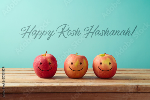 Jewish holiday Rosh Hashanah background with smiling apples