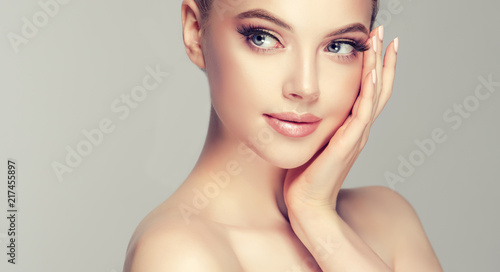Fototapeta Beautiful Young Woman with Clean Fresh Skin look away .Girl beauty face care. Facial treatment . Cosmetology , beauty and spa . 