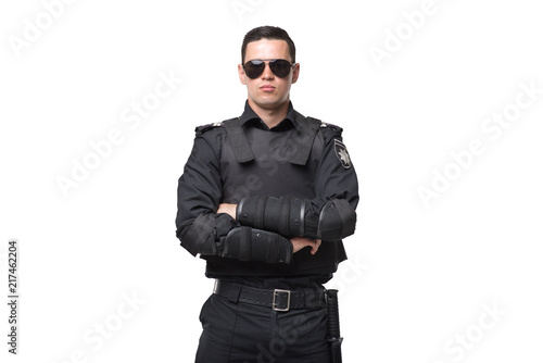 Cuadros en Lienzo Seriuse cop in sunglasses, uniform with body armor
