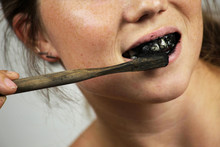 Young Woman Brushing Her Teeth...