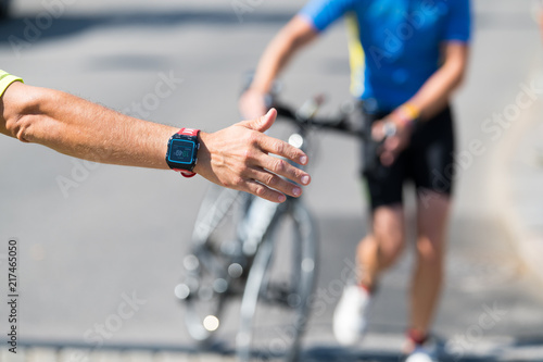 Race official, transition marshall directs triathlon athletes to the transition Canvas Print
