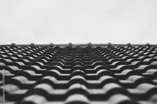 Fotografia Close up  roof tile of the house selective focus B&W.