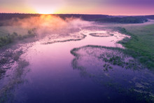 Aerial View Of Countryside And River In Early Misty Morning. Trees Along River. The Time Before Sunrise. View From Above