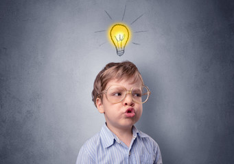 Obraz Adorable little kid mull over in front of a grey wall with idea symbol above his head