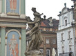 Picture on the wall of Town hall (Ratusz Poznanski) and beautiful sculpture in old town of the city, market square, sunny day, Poznan, Poland