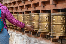 Woman Hand's With Spinning Tibetan Buddhist Prayer Wheels At Alchi Village Temple, Ladakh India.
