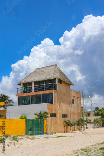 Fotografie, Obraz  House in Mexican village built tall for ocean view over the roofs of other build