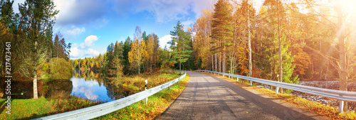 beautiful landscape on a highway in autumn. Road at falls on sunny day