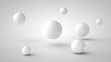 the image of the group of balls of the white drop-shadow, and randomly located in space, on a white background. 3D rendering.