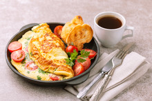 Herb Omelette With Tomatoes And Panini Toasts. Coffee. Breakfast