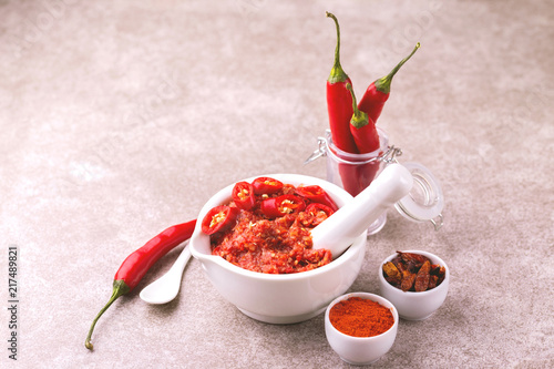 Spoed Foto op Canvas Hot chili peppers Traditional Maghrebi hot chili pepper sauce paste harissa. adjika