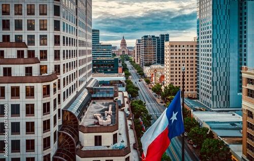 Photo Texas Flag Over Congress Avenue In Austin, Texas
