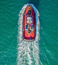 Speeding Tug Boat
