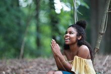 Excited Ethnic Young Woman Praying