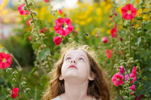 Little Girl Is Looking Up At The Bee. Facial Emotions Of Fear, Fright.