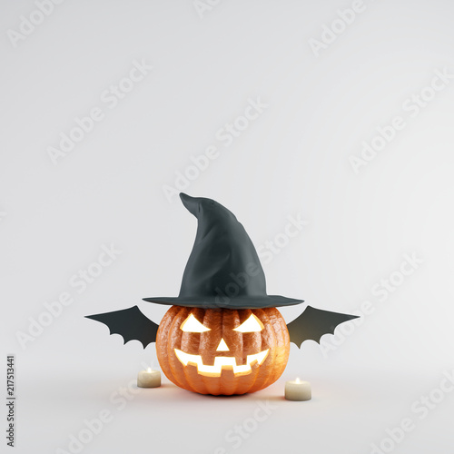 Photo Halloween Pumpkin with wizard hat and bat wings on white bright background