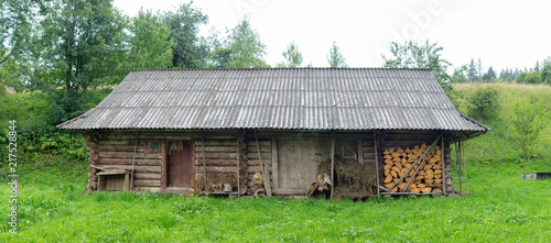 Fotografie, Tablou Traditional old wooden barn in the highlands of the Carpathians.