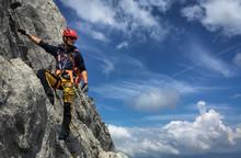 Young Man Climbing On A Rock I...