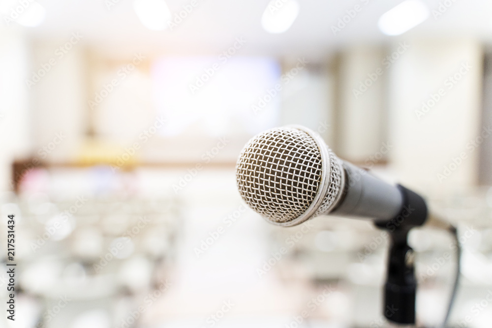 Fototapeta Microphone over the blurred business forum Meeting or Conference Training Learning Coaching Room Concept, Blurred background