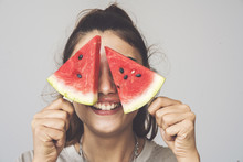 Young Woman Holding Watermelon...
