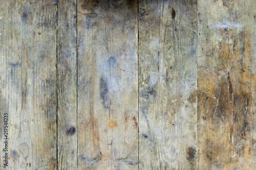 Obraz Old wooden planks from a workbench that are dirty and soiled with oil and rust - fototapety do salonu