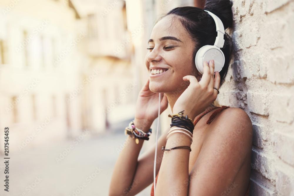 Fototapeta Beautiful young girl listening music