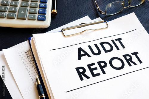 Photo Audit report with business documents in an office.