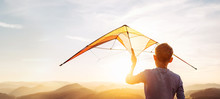 Boy Prepare Start To Fly A Kite Over The Sunset Mountain Hills