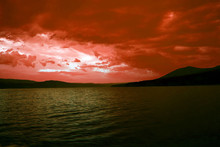 Beautiful Sunset On The Coast. The Sun Sets In The Mountains. Twilight In The Mountains. Night Landscape.