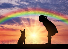 Silhouette Of A Baby Girl And Her Dog On A Background Of A Sea Sunset And A Rainbow