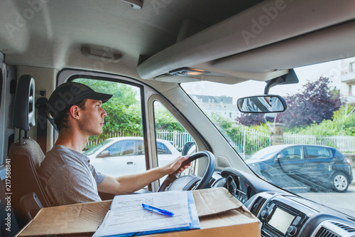 delivery transportation service job, driver man with package box driving truck car vehicle
