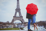 Fototapeta Fototapety Paryż - romantic holidays for couple in Paris, honeymoon vacation in France, Europe, man and woman kissing near Eiffel tower