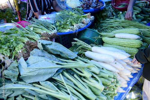 Photo  Chinese broccoli , eggplant, radish,and vegetables sold in the market in the mor
