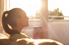 Girl Enjoying Morning Coffee I...