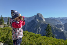 Little Girl With Binoculars At...
