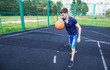 young man playing basketball outdoor