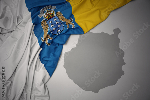 Deurstickers Canarische Eilanden waving colorful national flag of canary islands and map of gran canaria.
