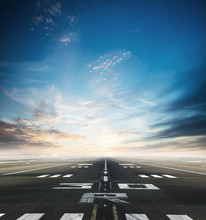 Empty Airport Runway With Dramatic Sky