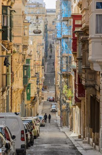 Poster Havana Valetta, Malta - June 2018: Couple enjoying a walk in the old city