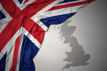 Waving Colorful National Flag And Map Of Great Britain.