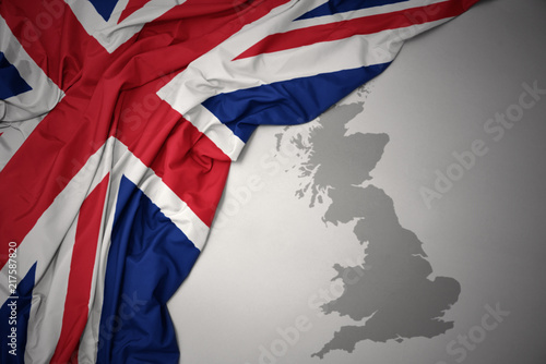 Obraz na plátně waving colorful national flag and map of great britain.