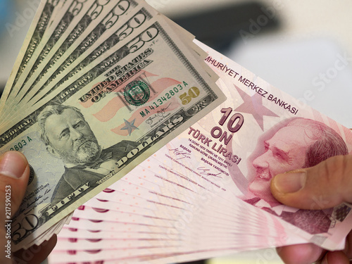 Photo  side by side american dollar and turkish lira banknotes